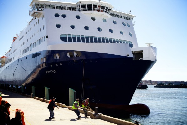 Dockworkers haul a bowline around a bollard as the Nova Star arrives in Portland for the first time on Thursday. The ferry will make daily runs between the city and Yarmouth, Nova Scotia, starting in May.