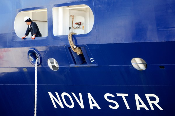 A crew member helps dock the Nova Star at the Ocean Gateway Terminal in Portland on Thursday. It was the vessel's first visit to the city.