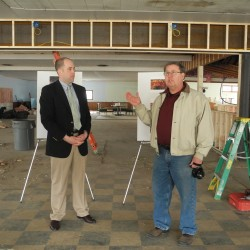 Seth Goodall (left), the New England Regional Administrator for the U.S. Small Business Administration, talks Wednesday afternoon with Donald Benson, the owner of ALLPLaY and ALLPLaY Belfast, about the soon-to-open family entertainment center off U.S. Route 1.