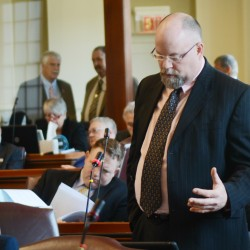 State Rep. Lance Harvell, R-Farmington, speaks in the Maine House of Representatives Monday urging his colleagues to override Gov. Paul LePage's veto of a bill that boosts a solar and heat-pump rebate program by adding a surcharge on all those who purchase electricity in Maine. The House voted 105 -41, in favor of overriding LePage's veto. The state Senate must also vote on the issue.