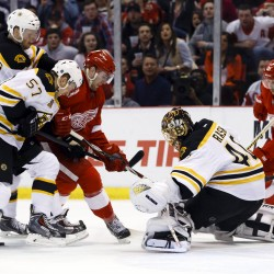 Boston Bruins goalie Tuukka Rask (40) makes a save on Detroit's Riley Sheahan (15) in the third period of Game 4 of their NHL playoff series at Joe Louis Arena. The Bruins won 3-2 in overtime.