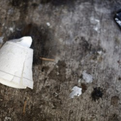 A crushed Styrofoam coffee cup lays on the ground in New York, Feb. 15, 2013.