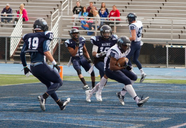 University of Maine senior Damarr Altman scores a touchdown during the annual Jeff Cole scrimmage at Morse Field, Saturday morning at the University of Maine.
