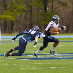 University of Maine sophomore Jordan Dunn runs with the ball during the annual Jeff Cole scrimmage Saturday morning at Morse Field at the University of Maine.
