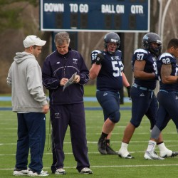 Head coach Jack Cosgrove sets up plays during the Jeff Cole Scrimmage on Morse Field at the University of Maine on Saturday morning.