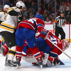 Montreal Canadiens goalie Carey Price (31) makes a save as Boston Bruins left wing Loui Eriksson (21) looks for the puck during the second period in the game six of the second round of the 2014 Stanley Cup Playoffs at Bell Centre in Montreal Monday night.