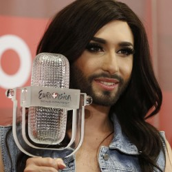 Austria's Conchita Wurst poses with her trophy after a news conference in Vienna May 11, 2014. Wurst, popularly known as &quotthe bearded lady,&quot won the 59th annual Eurovision Song Contest on Saturday with the James Bond-theme-like ballad &quotRise Like a Phoenix&quot, before a global TV audience of about 180 million people in 45 countries.
