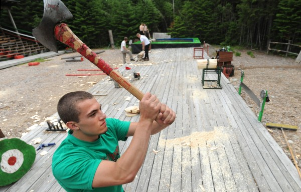 Sam Smith practices axe throwing at The Great Maine Lumberjack Show in Trenton. Smith, a Sumner High School student, is one of the lumberjacks who will appear in &quotTimber&quot Tina Scheer's show this summer, which is a unique, old-fashioned show combining old- and new-style lumberman skills.