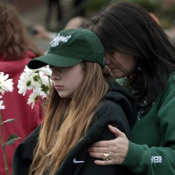 A rally for justice for all victims of sexual assault was held, October 22, 2013, on the square in Maryville, Missouri. Cortney Cooper, right, of Lee's Summit embraced her daughter, Tatum Cooper, 13, during the event.