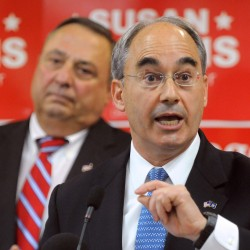 Former state treasurer Bruce Poliquin speaks at a rally at Husson University earlier this month. Poliquin is running for the 2nd District seat in Congress. On the left is Gov. Paul LePage.