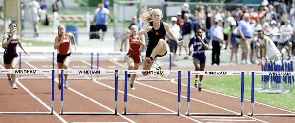 Brewer's Synclaire Tasker clears her hurdle way ahead of her opponents for an easy 45.47-second first-place win in the Class A State girls' 300 meter hurdles Saturday in Windham.