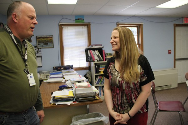 Megan Fowler and John Hubble, her case manager at Nokomis Regional High School, joke around in his classroom during lunch on Tuesday.