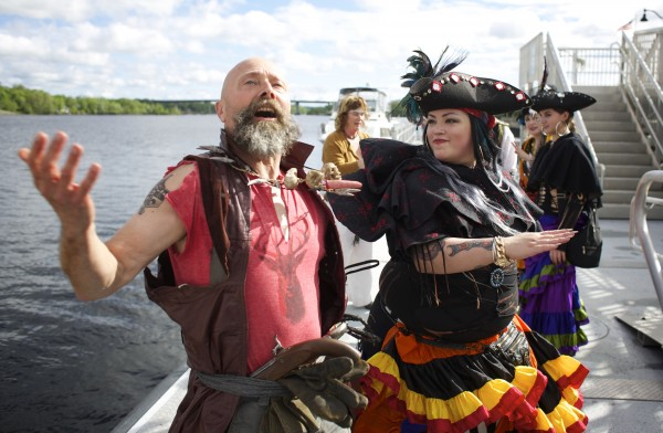 Kip &quotJacklash Lannagin&quot Nelson (left) receives a fake slap from Captain Ao Harker (center) after the pirate ship the Dark Rose was docked at the Bangor Waterfront on Friday afternoon.