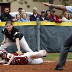 Bangor's Alexis Stanhope (right) safely dives to third past Brewer's Alexis Getchell during their Class A quarterfinal softball game Thursday at Bangor.