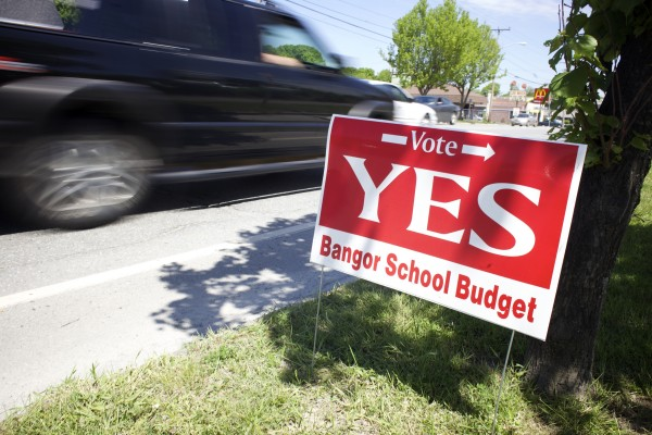 A sign paid for by the Bangor Education Association encourages voters to vote in favor of the Bangor school budget.