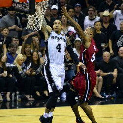 San Antonio Spurs guard Danny Green (4) dunks the ball against Miami Heat forward Rashard Lewis (9) during the second half in game one of the 2014 NBA Finals Thursday night in San Antonio.