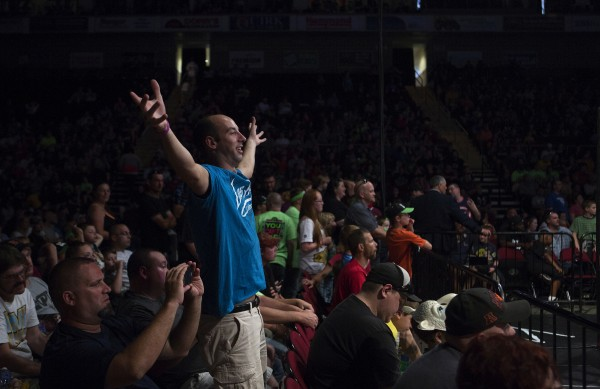Travis Ellis cheers on his favorite wrestler during WWE Live in Bangor Saturday at the Cross Insurance Center.