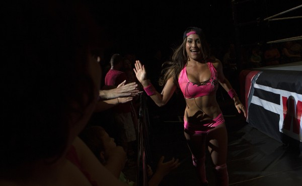 Nikki Bella high-fives fans during WWE Live in Bangor Saturday at the Cross Insurance Center.