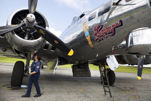 Loadmaster Kristin Purcell wipes oil off the underside of the Sentimental Journey, a fully restored B-17 Flying Fortress, at the Hancock County-Bar Harbor Airport Tuesday in Bar Harbor.