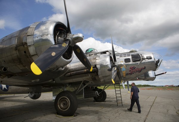 Loadmaster Chris Allen inspects the underside of the Sentimental Journey, a fully restored B-17 Flying Fortress, at the Hancock County-Bar Harbor Airport Tuesday in Bar Harbor.