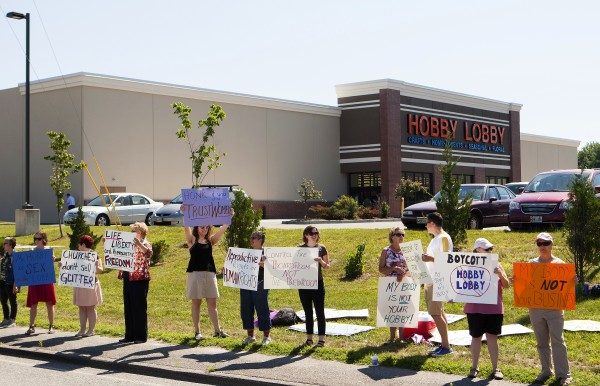 Around 50 people came out to show their support for women's rights during a protest against the recent Supreme Court decision about birth control and Hobby Lobby on Saturday outside the Bangor Hobby Lobby.