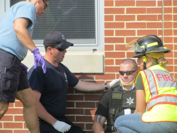 Waldo County Sheriff's Office Deputy Nick Oettinger is checked on by emergency personnel Saturday morning during an emergency drill simulating a school shooting at Mount View High School in Thorndike.