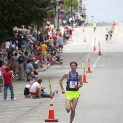 Adam Goode leads the pack during the 34th annual Walter Hunt Memorial Fourth of July 3K road race Friday. He won with a time of 8 minutes, 44 seconds.
