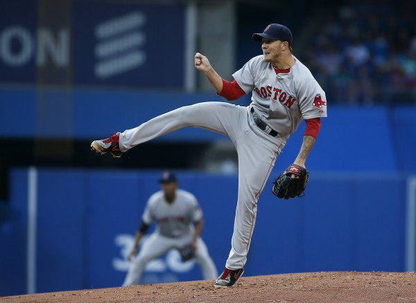 Boston Red Sox starting pitcher Jake Peavy follows through on a pitch against the Toronto Blue Jays at the Rogers Centre on July 22. Peavy has been traded to the Giants, sources revealed Saturday.
