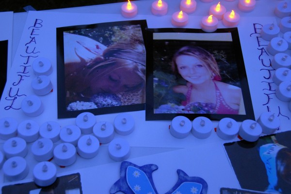 Electric vigil candles and mementos adorn a table at a vigil for missing Maine native Danielle Bertolini at Cascade Park on Saturday, July 19, 2014.
