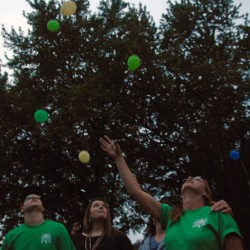 Danielle Bertolini's mother, Billie-Jo Dick of Plymouth, second from right, releases balloons at a vigil for her missing daughter at Cascade Park on Saturday, July 19, 2014.