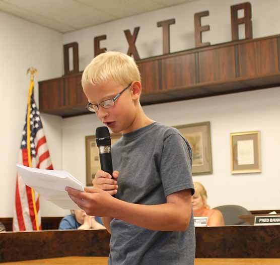 Local student Seth Hocking read an essay he wrote at the beginning of the Dexter Town Council meeting last week about his opposition to the east-west highway.