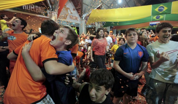 Fans celebrate after the penalty shootout while watching a broadcast of the 2014 Brazil World Cup quarterfinal game between Costa Rica and the Netherlands in Holambra, a Dutch immigrant colony north of Sao Paulo, July 5, 2014.  Netherlands advanced with a 4-3 victory.