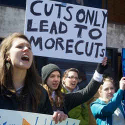 University of Southern Maine business and economics major Laine Geistwalker (left) protests deep cuts proposed by President Theo Kalikow on March 24 in Portland.