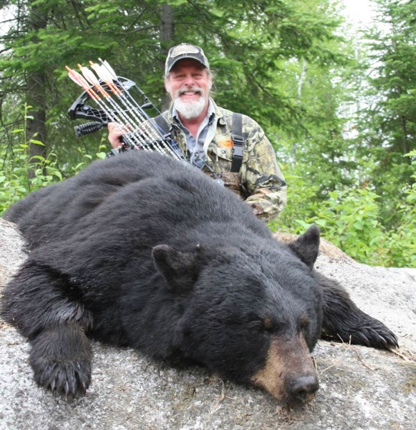 Ted Nugent poses with a black bear he shot in Quebec in 2013.