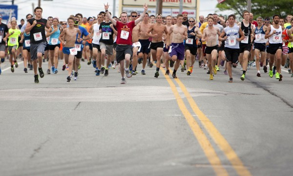 Runners make their way to Bangor at the start of the 34th annual Walter Hunt Memorial Fourth of July 3K road race Friday. The race starts in Brewer and travels into Bangor.  A total of 566 runners finished the race.