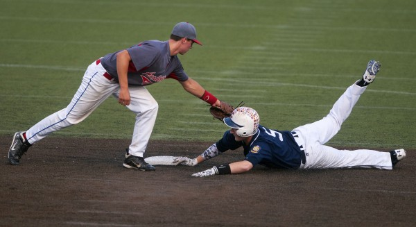 BANGOR, MAINE -- 07/26/14 -- Trenton's Tony Bianco (left) tags Bangor's Andrew Hillier out at second during a Zone 1 American Legion baseball state-qualifying game at Husson University in Bangor.