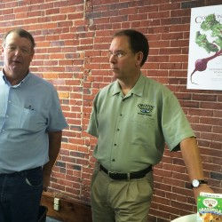Vaughn Chase (left) owner of Chase's Organic Dairy Farm and former MOO Milk producer, speaks about his decision to join the Wisconsin-based cooperative Organic Valley at the company's Congress Street office.
