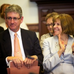 Maine Deputy Attorney General William Stokes smiles, and his wife Diane Doyen applauds, as the Judiciary Committee unanimously votes to recommend him for a judgeship on the Superior Court in Augusta on Thursday.