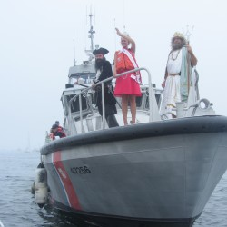 A U.S. Coast Guard boat docks at the Rockland public landing to drop off the 2013 Maine Sea Goddess, King Neptune, Blackbeard, and their entourage, as the 67th annual Maine Lobster Festival kicked off in Rockland. The Festival runs through Sunday.