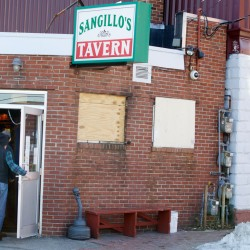 Patrons enter Sangillo's Tavern on Hampshire Street in Portland last March.