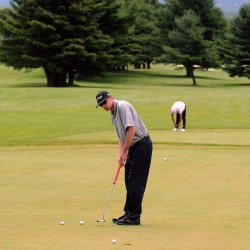 Players warm up on the practice greens before their tee time on the first day of the Greater Bangor Open at the Bangor Municipal Golf Course on Thursday.