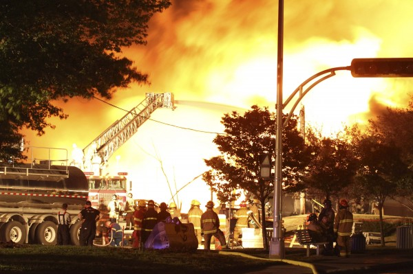 First responders fight burning trains after a train derailment and explosion in Lac-Megantic, Quebec early July 6, 2013.
