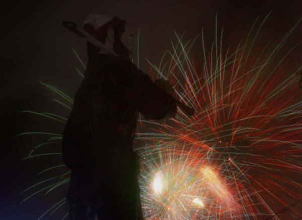 Paul Bunyan stood in the glow of Bangor's Fourth of July fireworks display Friday,  July 4, 2014.  The fireworks display went off with a bang in spite of the weather.