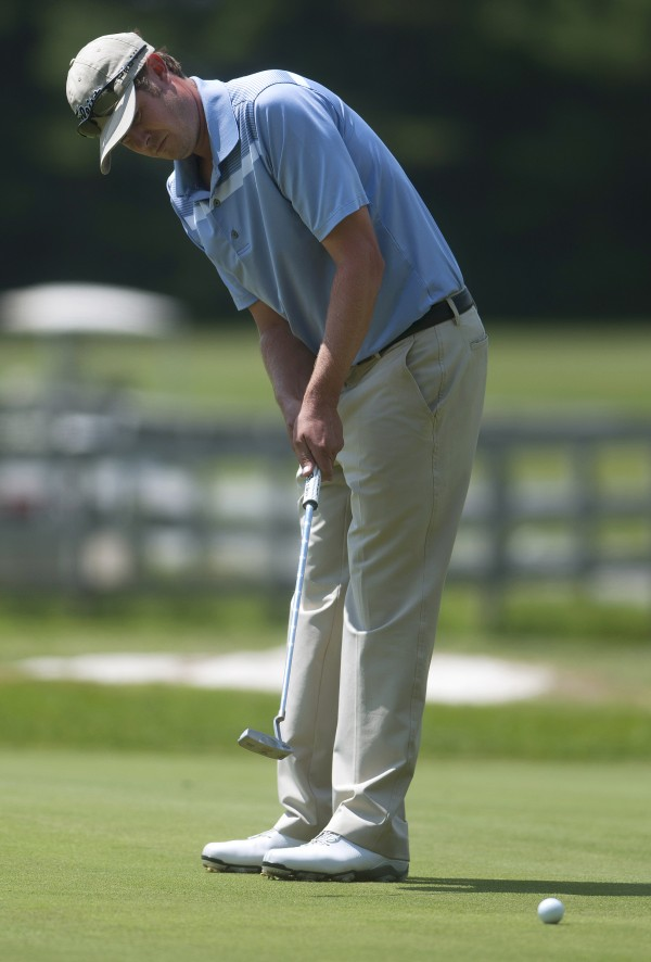 Jesse Larson putts during the second round of the Greater Bangor Open Friday at the Bangor Municipal Golf Course.