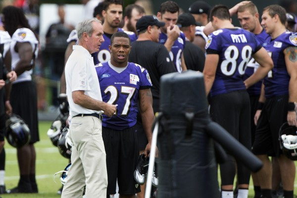 Baltimore Ravens team president  Richard W. Cass  speaks with  running back Ray Rice (27) after practice Thursday at Under Armour Performance Center in Owings Mills, Maryland.