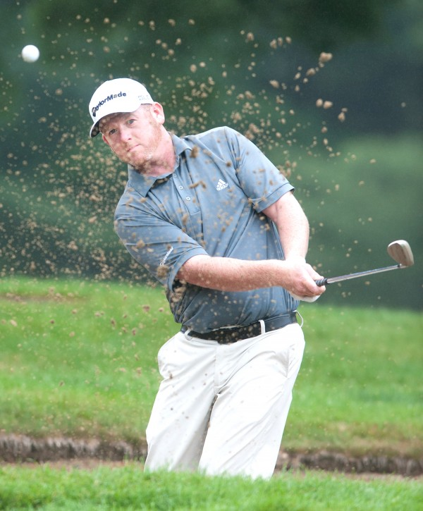 Shawn Warren, who won the Maine Open as an amateur in 2004, chips out of the 10th bunker at the Augusta Country Club Monday morning during the opening round of the 2014 Charlie's Maine Open that was eventually washed out.