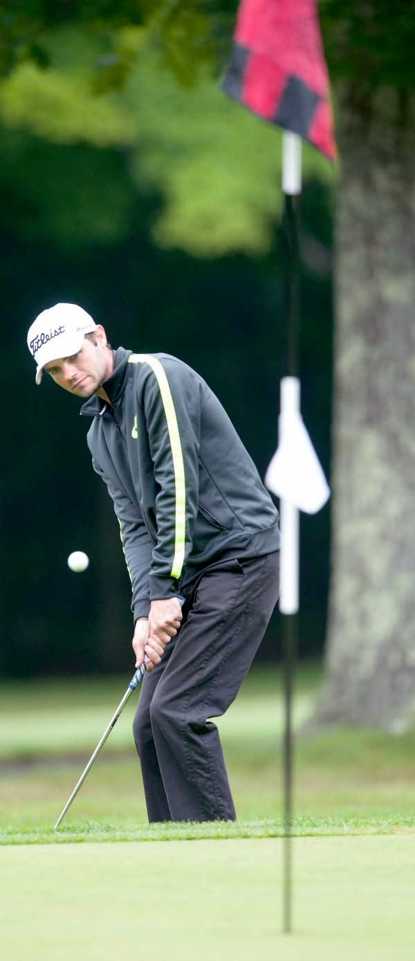 Brian Bilodeau watches his chip shot from the fringe of the 15th green that rolled in for a birdie at the Augusta Country Club Monday morning during the opening round of the 2014 Charlies Maine Open that was eventually washed out.