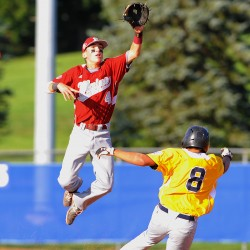 Bangor's Kyle Stevenson (left) jumps off second base to make a catch as U.S. West's Sanyo Lo slides safely to second base during a Senior League World Series game at Mansfield Stadium in Bangor last season. Stevenson and Bangor return to the Senior Little League World Series on Aug. 10.