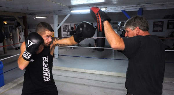 Professional boxer Brandon Berry (left) of West Forks works out with his trainer Ken &quotSkeet&quot Wyman at Wyman's Boxing Club in Stockton Springs. Wyman a former boxer, started the club 10 years ago and Berry is the first professional boxer he has trained.
