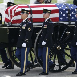 A caisson carries the casket of U.S. Army Major General Harold J. Greene before a full military honors burial ceremony at Arlington National Cemetery in Virginia, August 14, 2014.